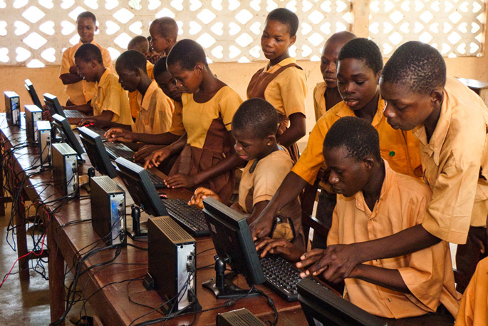 Kasu, Ghana<br>Students use the computers during class. The seven-computer lab serves more than 200 students.