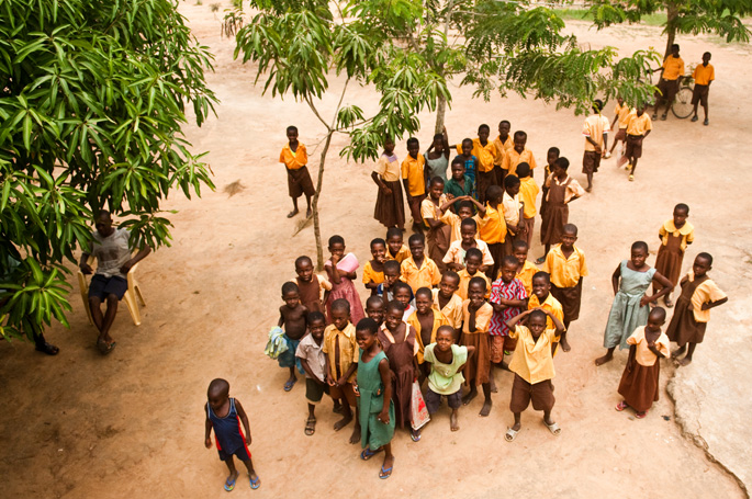 Kasu, Ghana<br>Students watch from the ground as we installed the solar panel on the roof.