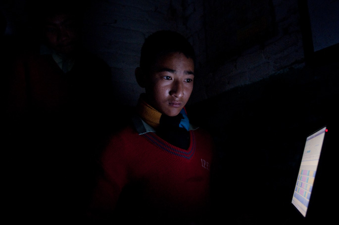 Kathmandu, Nepal<br>A student uses a SolarLEAP computer during a power outage.