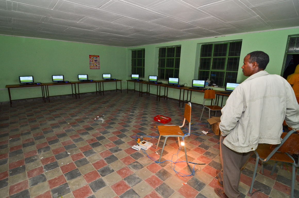 All fifteen computers running off of battery power for final testing the night before the official opening ceremony at the Gum Selasa Elementary School.